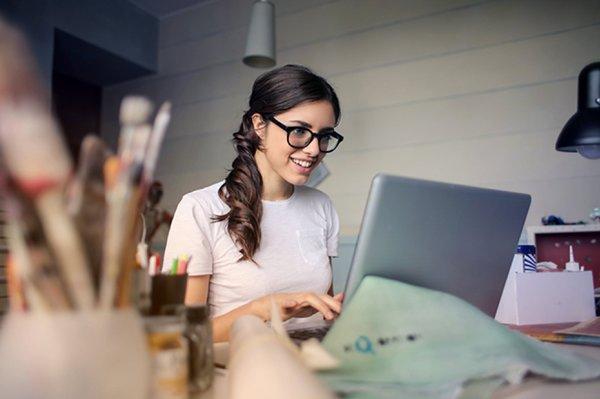 interior designer working at laptop